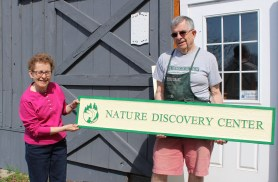 Nature Discovery Center sign with Sandra Martin, Director